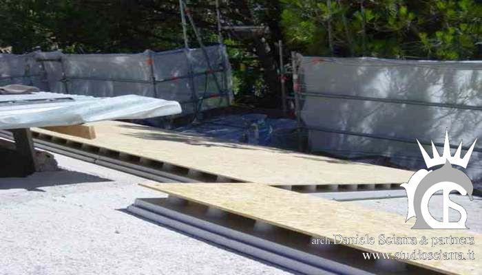 bioedilizia: tetto ventilato con pannelli isolanti e camera d'aria