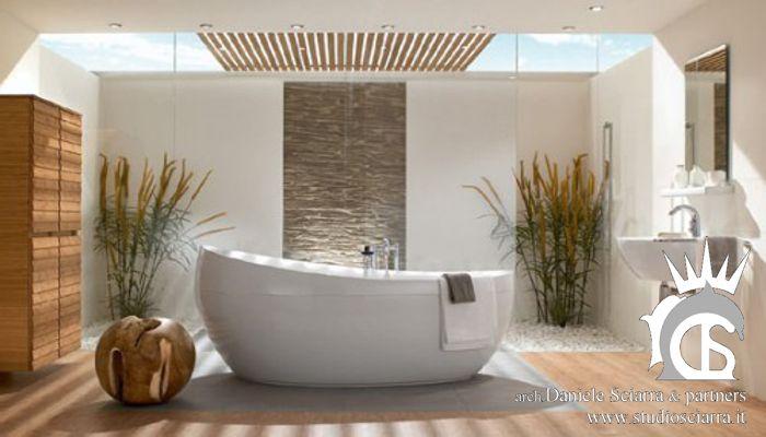Bagno con zona doccia e vasca al centro modello a gozzo