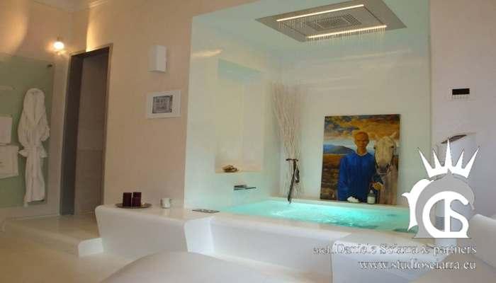 Bagno benessere in resina bianca, bagno turco e vasca idro di coppia