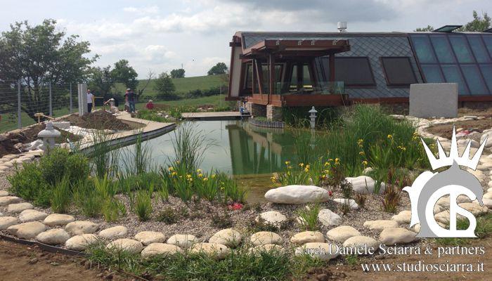 Progettazione ville in legno con laghetti biologici