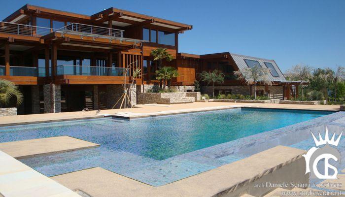 Progetto e realizzazione villa in legno con piscina