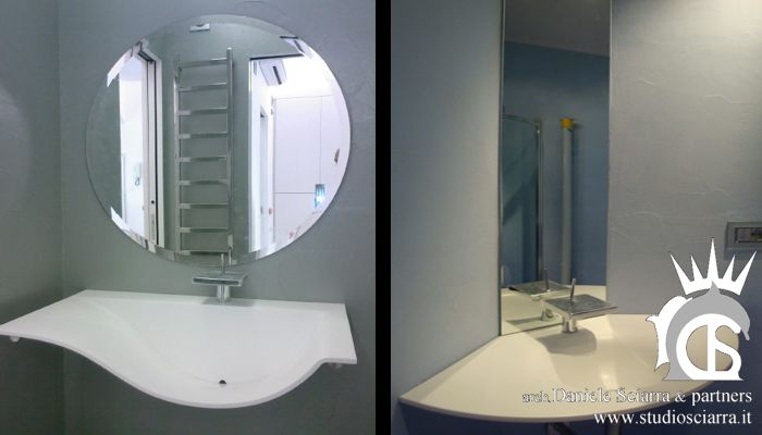 I bagni in resina con i lavabi in Corian