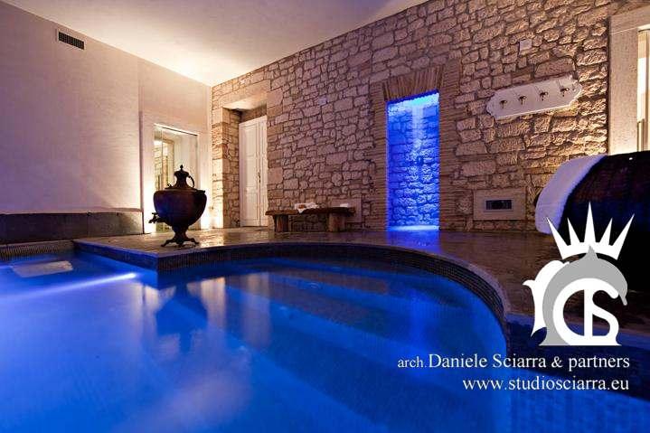 progettazione centri benessere architetto con piscina idromassaggio e realizzazione centri benessere architetto con piscina idromassaggio al castello di montignano
